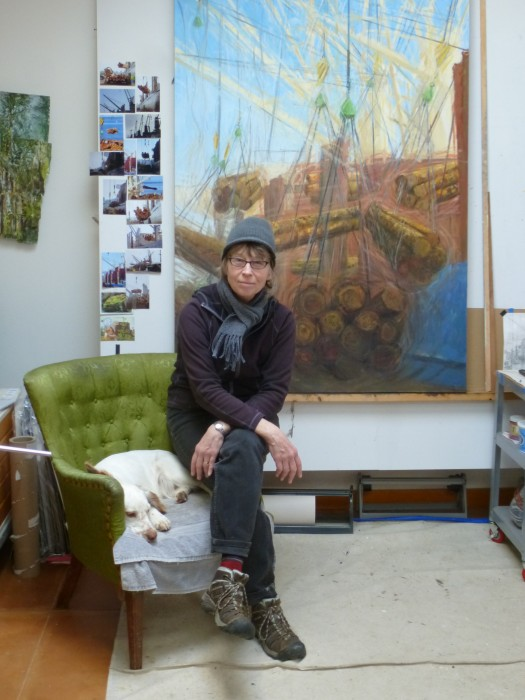 The artist in her studio with her trusted assistant, Tag.